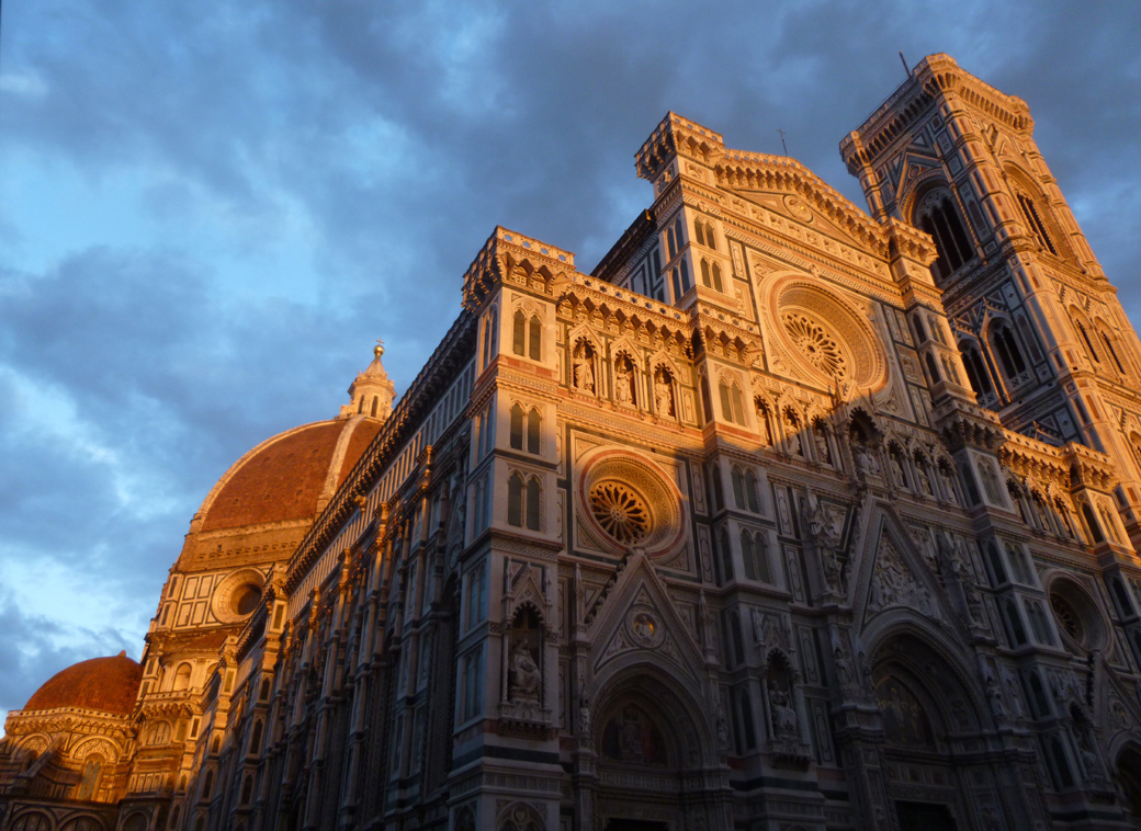 The Cattedrale di Santa Maria del Fiore is the main church of Florence, Italy known also as Il Duomo di Firenze at sunset with Seen by Solomon travel blog