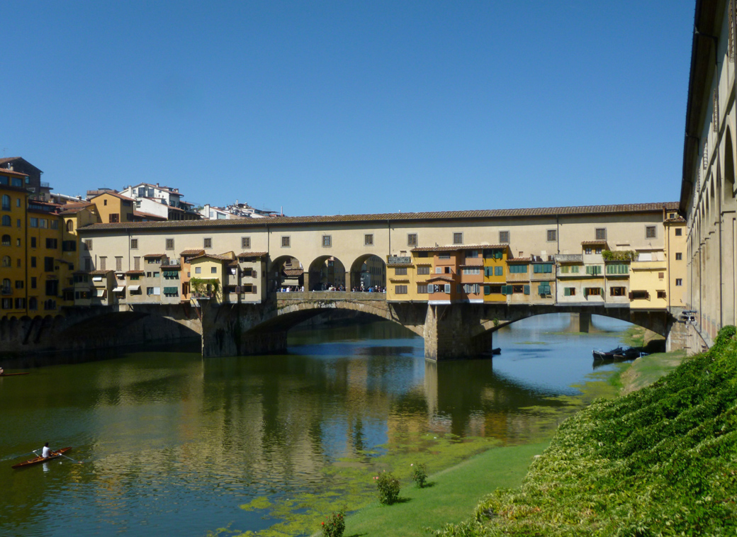 Florence Italy view of Ponte Vecchio medieval stone bridge with Seen by Solomon travel blog