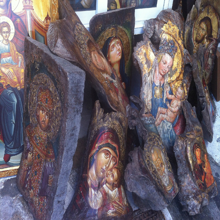 religious paintings on large chunks of wood in Mykonos Greece with Seen by Solomon travel blog. spotted 6