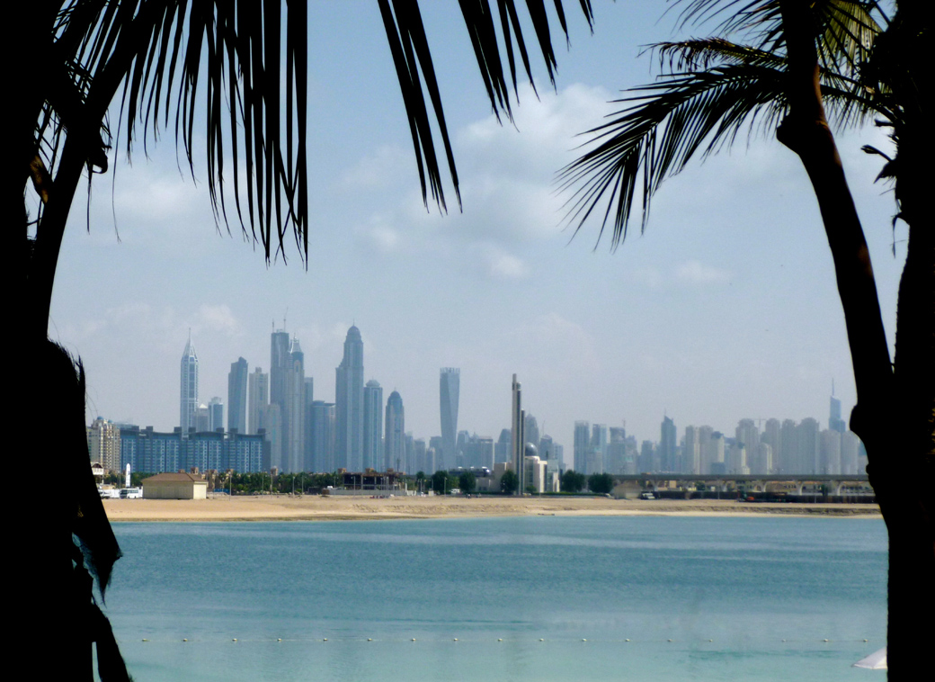 view over to the city from the Atlantis Palm Dubai UAE private beach with Seen by Solomon travel blog