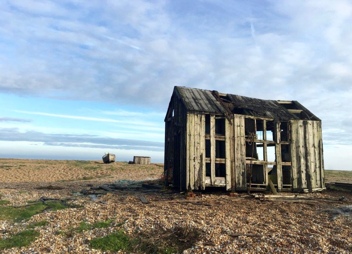 Dungeness Kent UK abandoned shack on shingle beach with Seen by Solomon travel blog