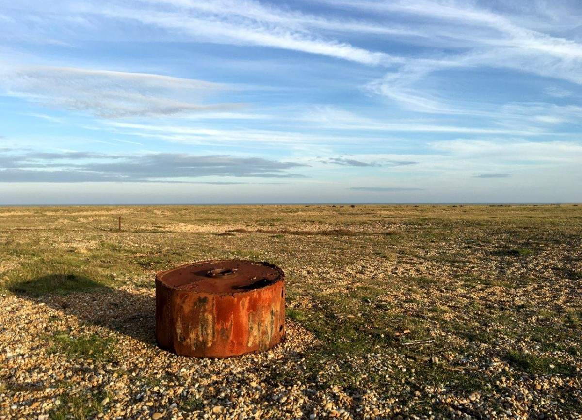 Dungeness Kent UK rusty drum abandoned on the shingle beach with Seen by Solomon travel blog