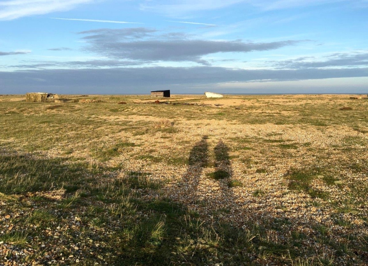 Dungeness Kent UK long shadows of us on the shingle at end of day with Seen by Solomon travel blog
