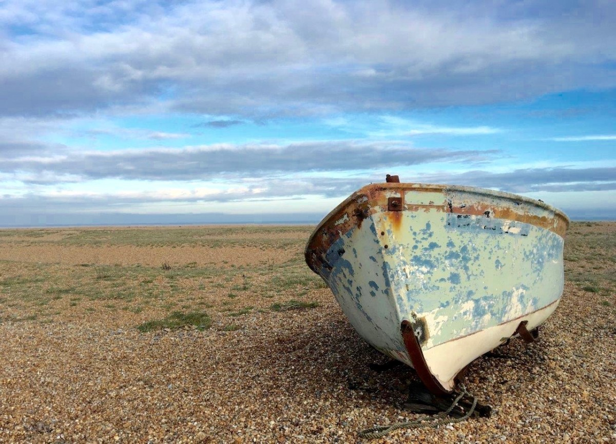 Dungeness in Kent UK shingle and abandoned boat with Seen by Solomon travel blog
