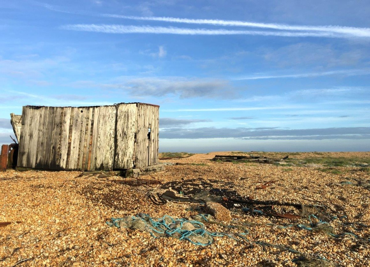 Dungeness Kent UK abandoned boat on shingle beach with Seen by Solomon travel blog