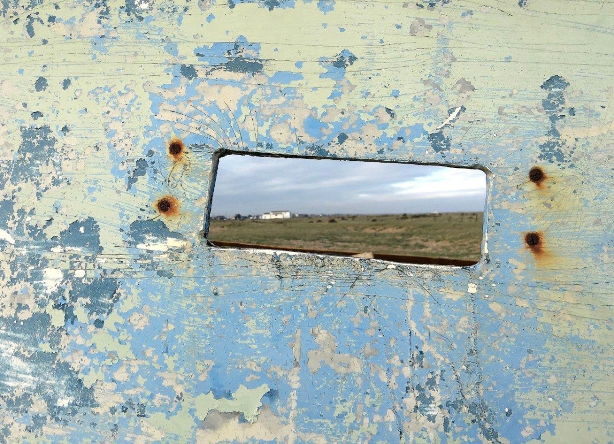 Dungeness Kent UK views through hole in abandoned boat with Seen by Solomon travel blog