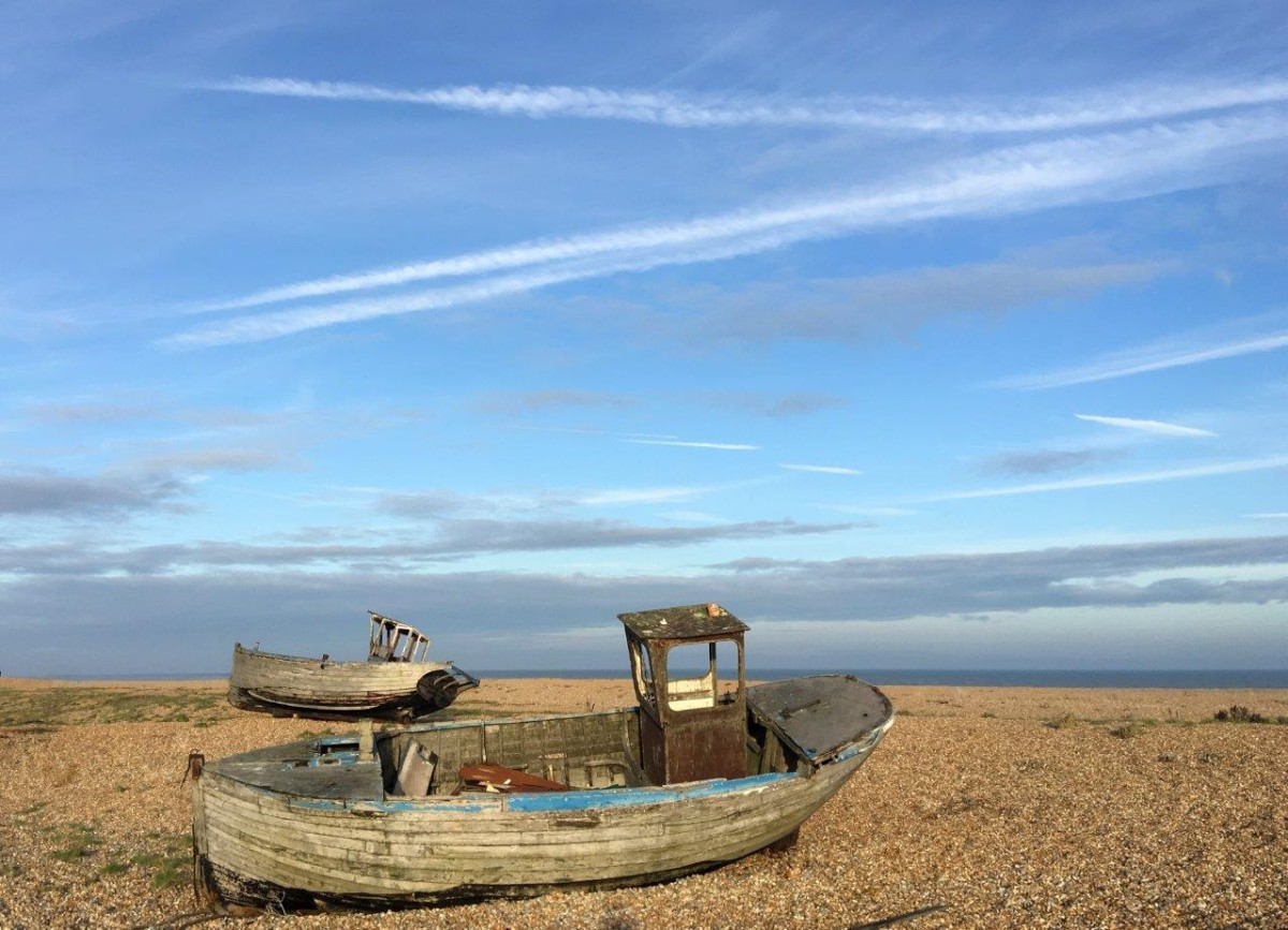 Dungeness Kent UK abandoned boats on shingle beach with Seen by Solomon travel blog