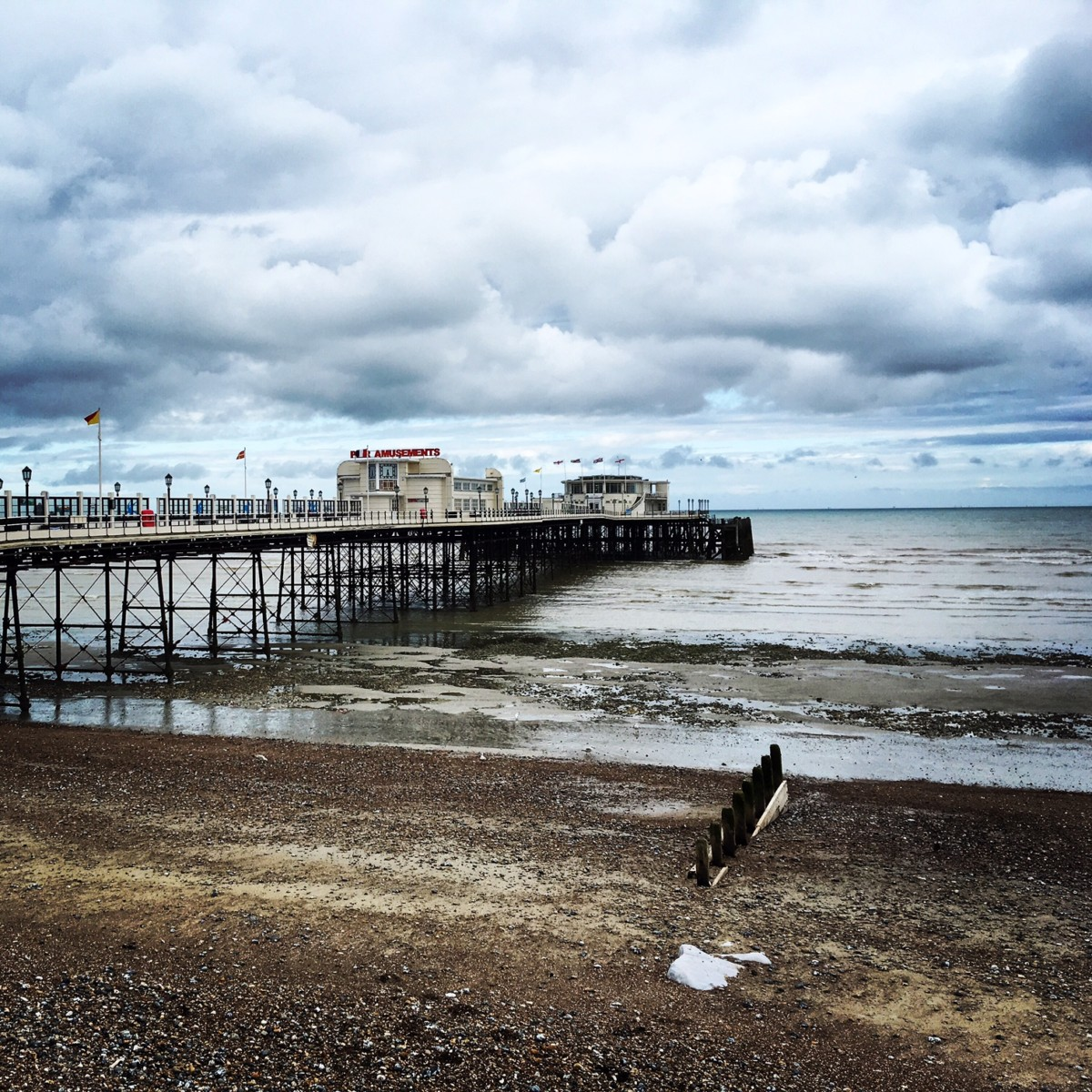 By the sea, West Sussex UK, pier with Seen by Solomon travel blog