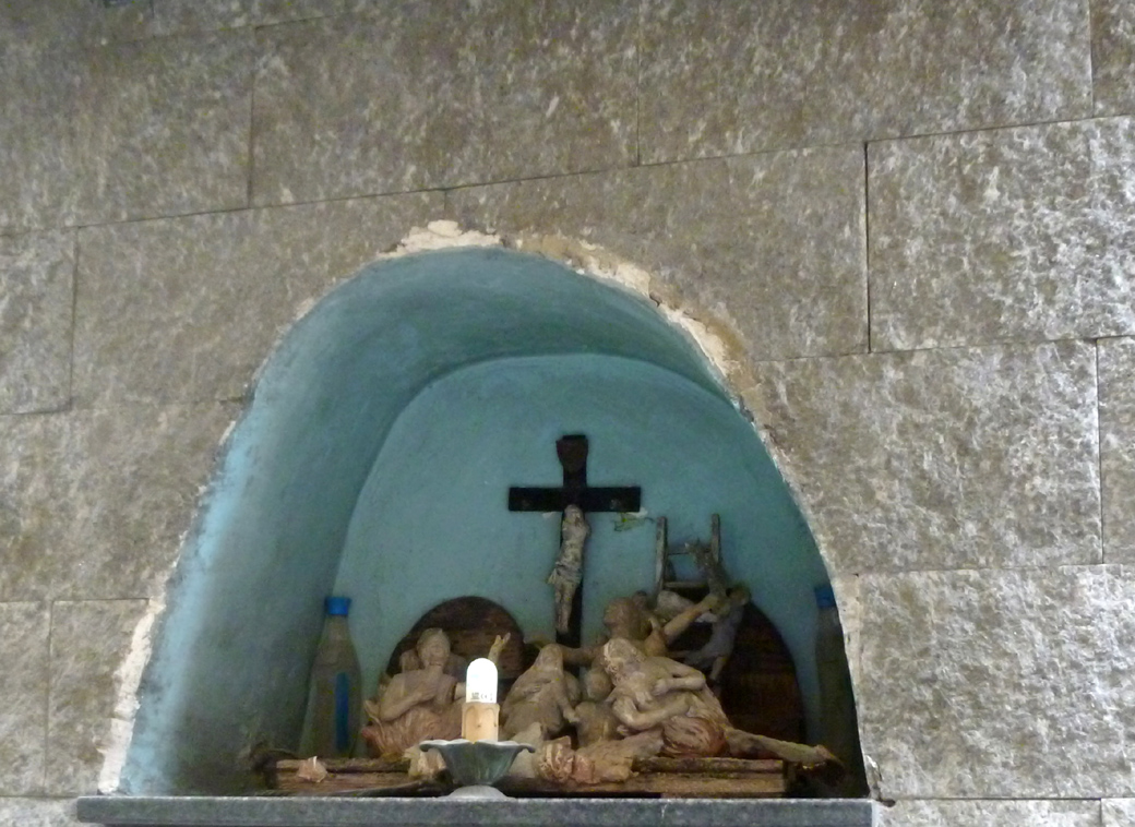 random religious items in a hole in the wall on a Naples Italy side street with Seen by Solomon travel blog