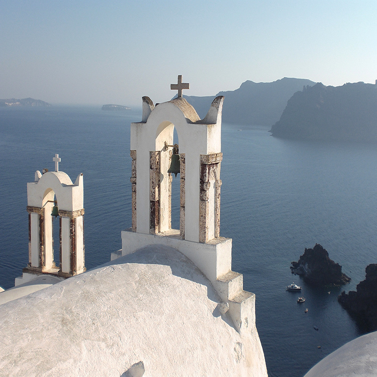 Santorini Greece bell tower of Oia with Seen by Solomon travel blog