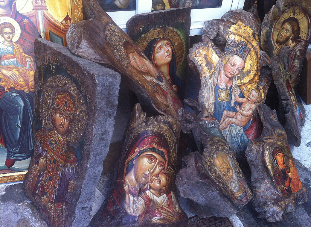 religious paintings on large chunks of wood in Mykonos Greece with Seen by Solomon travel blog . spotted 6